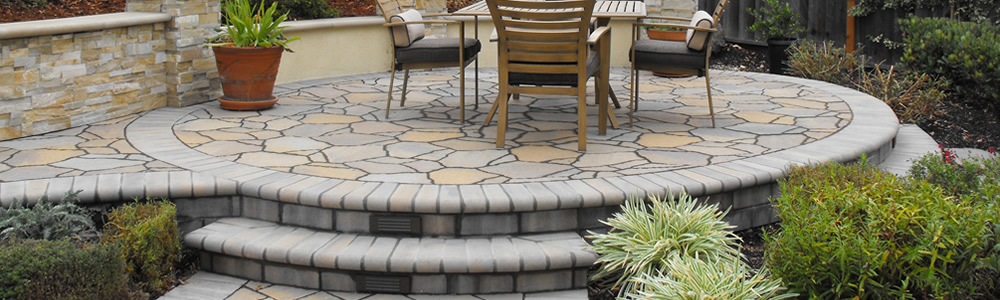 https://www.jennifercravenlandscape.com/wp-content/uploads/2014/05/interlocking-pavers-landscaping.jpg